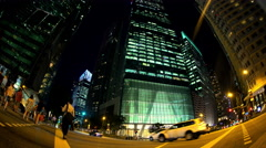 Singapore - September 2016: Fish Eye view at night of illuminated Skyscraper Stock Footage
