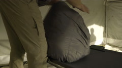 Men Setup Their Hunting Tent, Unrolls Sleeping Bag On Cot, Sets Down Gear Nearby Stock Footage
