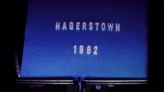 1962: blue sheet of paper with words written on the front HAGERSTOWN, MARYLAND Stock Footage