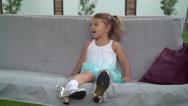 Kid swinging at the backyard in summer season Stock Footage
