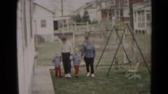1962: family holding hands walking past playground swingset park HAGERSTOWN Stock Footage