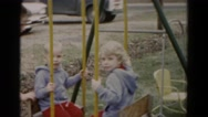 1962: two brothers being pushed on swing HAGERSTOWN, MARYLAND Stock Footage