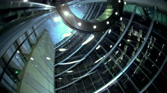 Ascending by floors vertical glass contemporary city elevator at night in modern Stock Footage