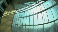 Descending by floors vertical glass contemporary city elevator in modern Stock Footage