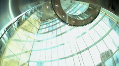 Modern day city glass elevator descending by floors in downtown skyscraper Stock Footage