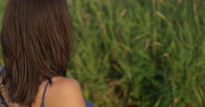 Beautiful Young woman turns to face camera -Copy space right- Slow motion Stock Footage