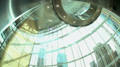 Descending day city glass elevator in modern skyscraper building in the downtown Stock Footage