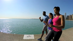 Multi Ethnic American male and females walking outdoors by Lake Michigan Chicago Stock Footage