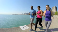 Active Ethnic African American male and females running in Chicago city outdoors Stock Footage
