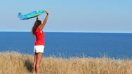 Slow motion.  Beautiful  sexy woman in red with cape  against  sea Stock Footage