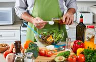 Chef man cooking in the kitchen. Stock Photos