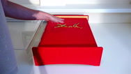 Big thick book covered with a red cloth with an engraving on the front of Stock Footage