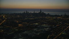 Aerial illuminated view at sunrise of Lake Michigan Chicago Skyscraper buildings Stock Footage