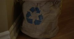 Recycling bin full of plastic - tilt up slow motion Stock Footage