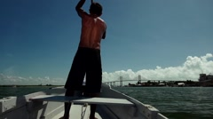 Fisherman rowing at boat in Natal, Brazil  Stock Footage