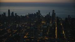 Aerial illuminated view at sunrise of Lake Michigan Chicago Skyscraper buildings Stock Footage