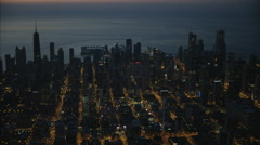 Aerial illuminated view at sunrise of Hancock Building Chicago Skyscraper Stock Footage