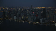 Aerial night illuminated view of Lake Michigan Hancock Building Chicago skyline Stock Footage