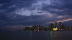 Toronto City Skyline and Harbour with Dramatic Evening Clouds Stock Footage