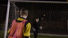 March 2016. British youth soccer players high five during training Stock Footage