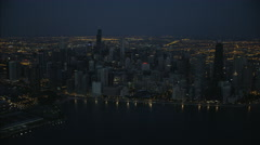 Aerial night illuminated view of Lake Michigan Waterfront Hancock Building Stock Footage