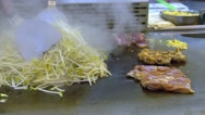 Slow motion Asia people cooking beansprouts and meat in Taiwan Night Market -Dan Stock Footage