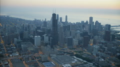Aerial illuminated view at sunrise of Lake Michigan Sears Tower Chicago city Stock Footage