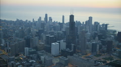 Aerial illuminated view at sunrise of Lake Michigan Willis Tower Chicago city Stock Footage