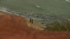 Surfers at Pipa beach in Brazil Stock Footage