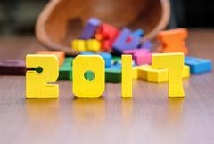 2017 new year number yellow color toy on wood table with other font toy, Holi Stock Photos