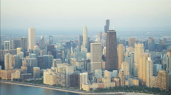 Aerial view at sunrise of Lake Michigan Hancock Center Chicago Skyscraper Stock Footage