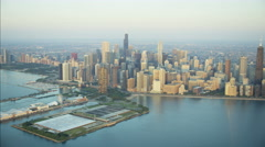 Aerial sunrise view of Lake Michigan Waterfront harbor Navy Pier Chicago skyline Stock Footage