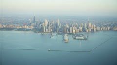 Aerial sunrise view of Lake Michigan Lighthouse harbor Waterfront Navy Pier and Stock Footage