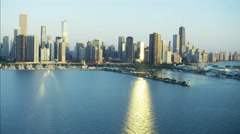 Aerial sunrise view of Lake Michigan Waterfront Navy Pier Chicago River skyline Stock Footage
