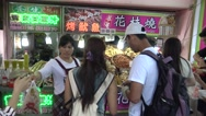 4k Asian People Buy fried squid and other fish food in Street night market -Dan Stock Footage
