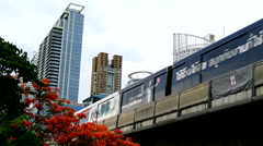 Sky train running on railway with tower building background Stock Footage