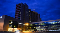 Health Care Modern Hospital Exterior Building at night. Time Lapse Stock Footage