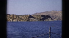 1958: waterside view of deep blue body of water in valley MONTANA Stock Footage