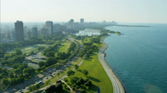 Aerial Chicago day view of Lake Michigan Lakeshore Drive vehicle traffic city Stock Footage