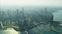 Aerial skyline view of Chicago Illinois Lakeshore Drive Millennium Park Navy Stock Footage