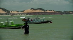 Pushing boat at pipa beach in Brazil Stock Footage