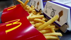 Close up fries and burgers at Mcdonald's restaurant Stock Footage
