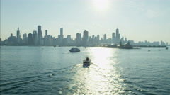 Aerial day view of ferries on Lake Michigan Navy Pier Chicago harbor Waterfront Stock Footage