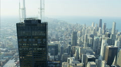 Aerial vertical overhead rooftop view of Sears Tower Metropolitan Chicago city Stock Footage