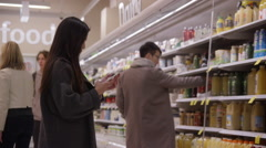 Lady using a smart phone at the supermarket Stock Footage