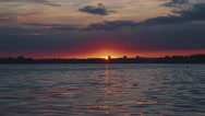 Sunset over the water. Interesting unusual light. Stock Footage