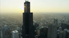 Aerial sunlight sunset view of Willis Tower Chicago Illinois Metropolitan Stock Footage