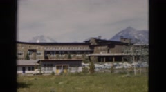 1958: panoramic view of mountain resort chalet and distant snowy mountains Stock Footage