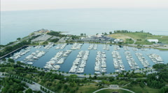 Aerial sunset view of Lake Michigan Waterfront Adler Planetarium and boat marina Stock Footage