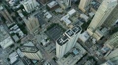 Aerial vertical overhead rooftop sunset view of Hancock Tower Chicago city Stock Footage